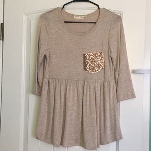 Cream blouse with glitter pocket detail